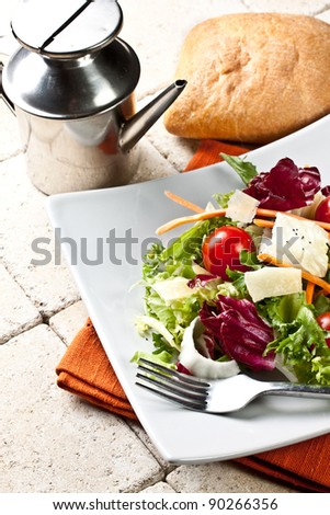fresh mixed salad served on a plate