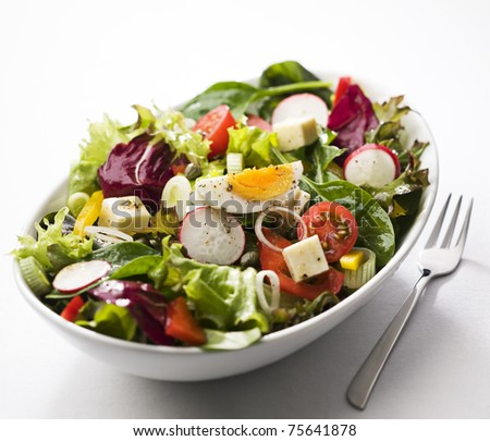 Fresh mixed salad with egg close up