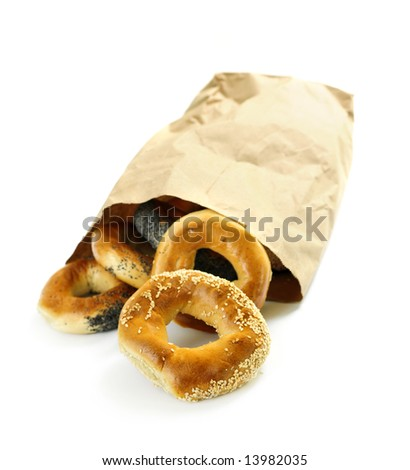 Fresh Montreal style bagels in paper bag on white background