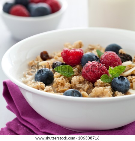 fresh muesli with fruits and milk