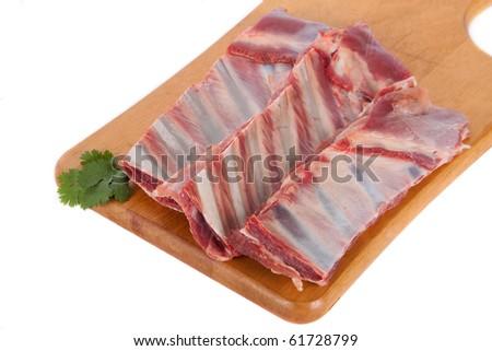 Fresh mutton meat on wooden board