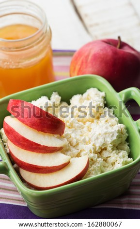 Fresh natural products - cottage cheese, apple, honey. Rustic style. Bio/organic/natural ingredients. Healthy eating.