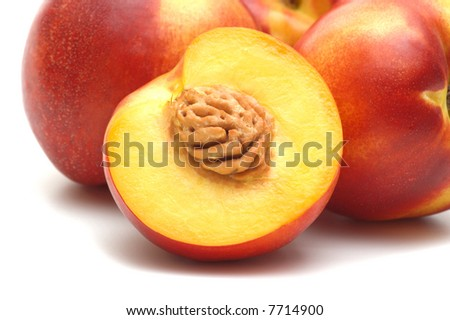 fresh nectarine on white background