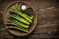 Fresh of green Asparagus. Cooking healthy meal. Bunches of green asparagus, top view- Image