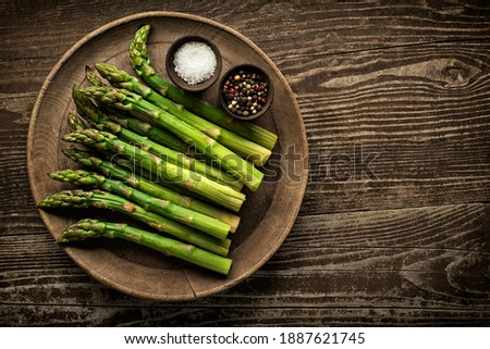 Fresh of green Asparagus. Cooking healthy meal. Bunches of green asparagus, top view- Image Stock photo ©