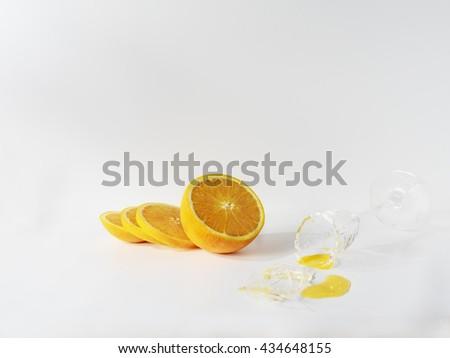fresh of orange with a  broken glass-white background #434648155