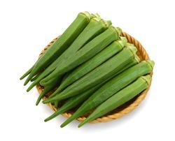 fresh okra fruits in basket isolated on white background
