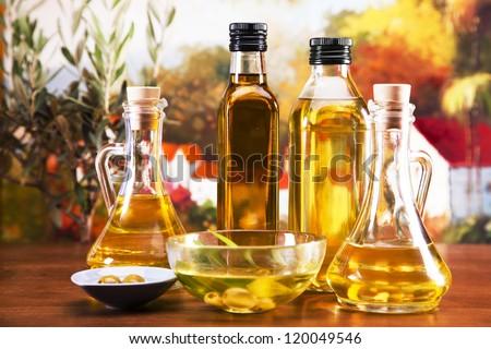 Fresh olives, olive oil on olive wood. Extra virgin