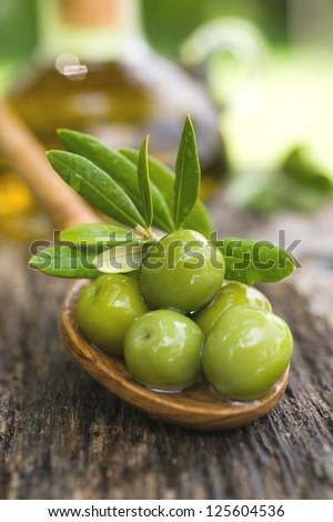 Fresh olives on a spoon