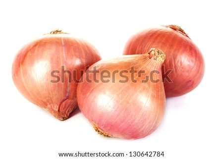 Fresh onions on white