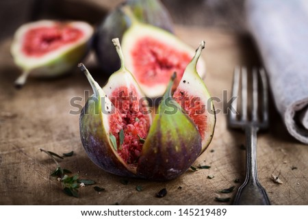 fresh opened figs on rustic wooden table