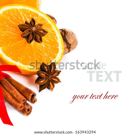 Fresh orange, Anise star, Cinnamon stick isolated. Spices for hot mulled wine isolated on white background, closeup.