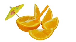 Fresh orange as a natural juice concept. Orange cocktail with tubule and umbrella. Isolated on white backdround