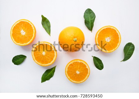 Fresh orange citrus fruit on  white wooden background. Juicy and sweet and renowned for its concentration of vitamin C