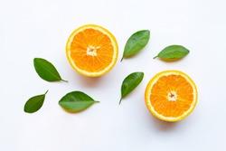 Fresh orange citrus fruits with leaves on white background.