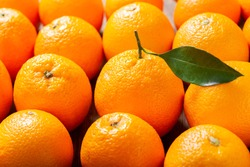 fresh orange fruits as background, top view