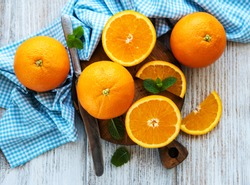 Fresh orange fruits on a old white wooden table