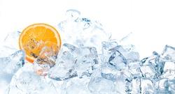 Fresh orange in ice cubes background.