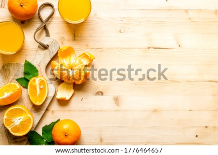 Fresh orange juice and citrus fruits, top view