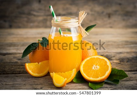 Fresh orange juice in the glass jar