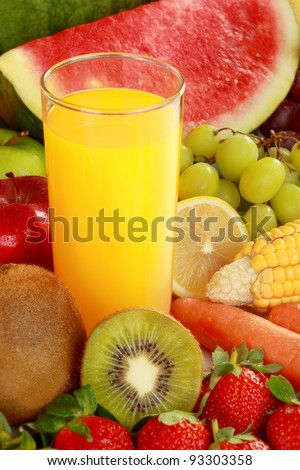 fresh orange juice in the middle of fresh fruits