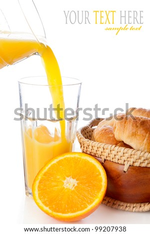 Fresh orange juice with croissants