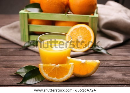 Shutterstock Fresh orange juice with fruits on table