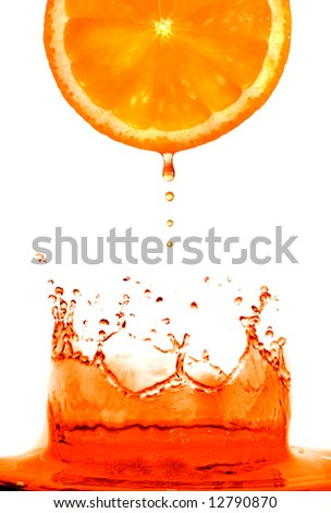 Fresh orange jumping into water with a splash