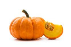 Fresh orange miniature pumpkin isolated on white background
