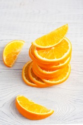 Fresh orange slices on a light background. Bright orange fruit is delicious, refreshing and healthy