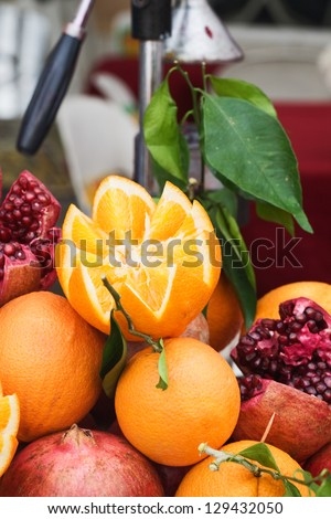 Fresh oranges and pomegranates on juice stand at market in Turkey