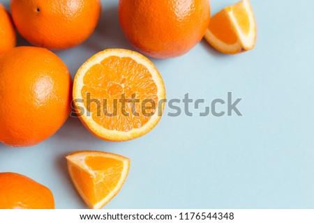 Fresh oranges on the blue background. Orange