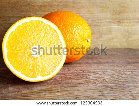 Fresh oranges on wooden background