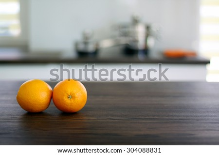 Fresh oranges on wooden tabletop in the kitchen