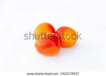 Fresh organic apricot on white background. Variety: galta roja, bulida. Other varieties: canino, Nancy, paviot, maniqui, currot. Cebas 57, Mirlo blanco,  Beta carotene and vitamins. Low calories food.