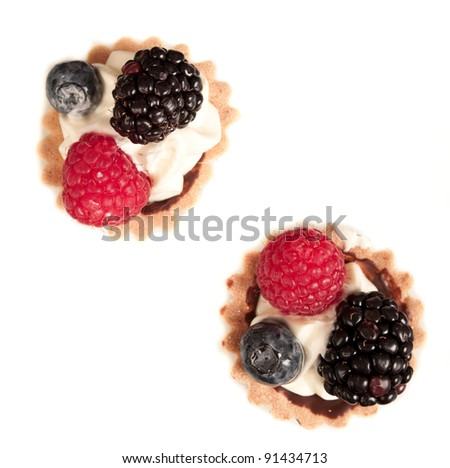 fresh organic baked fruit tarts on a white plate