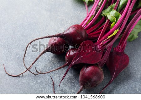 Fresh organic beet, beetroot. Grey stone  background. Close up.