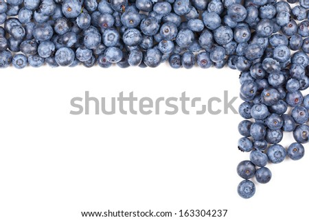 Fresh organic blueberries forming frame over white background
