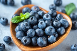 Fresh organic blueberries in a bowl closeup view