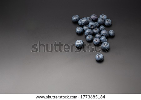 Fresh organic blueberries isolated on black background with copy space for text