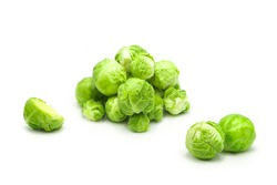Fresh organic brussels sprouts whole and halves isolated on white background.