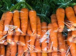 fresh organic carrot in the plastic bag on the local market.Thailand.