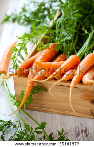 Fresh organic carrots in a wooden  box