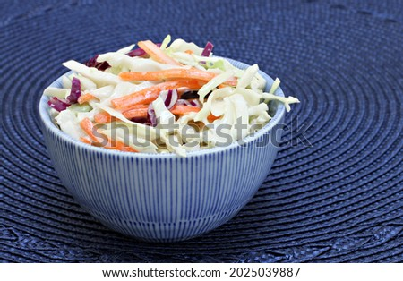 Fresh, organic cole slaw in a blue and white dish. Photo stock ©
