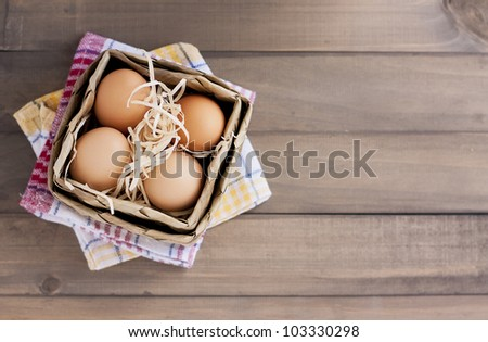 fresh organic eggs on a rustic table