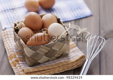 fresh organic eggs on rustic table