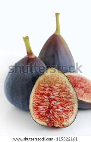 Fresh, organic figs isolated on white.  Whole and sliced figs together. - stock photo