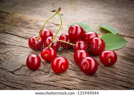 Fresh organic fruit - cherry on wood background selective focus