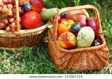 Fresh organic fruits and vegetables in wicker baskets outdoors