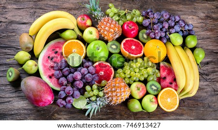 Fresh organic fruits background. Healthy eating concept. Flat lay.